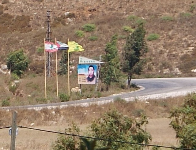 (Hezbollah flag and sign near Metula, Israel)(photo Hadar Sela)