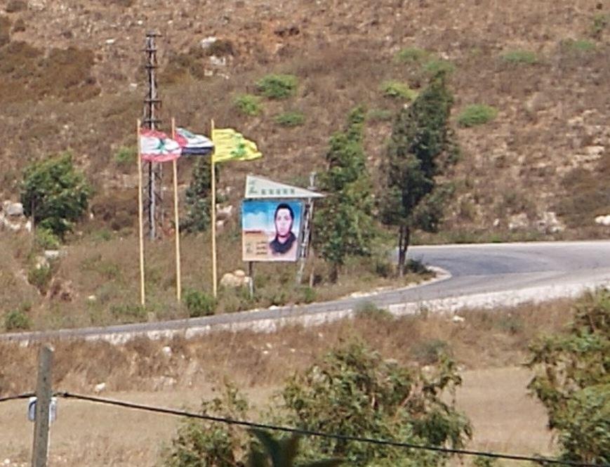 (Hezbollah flag and sign near Metula, Israel)(photo Hadar Sela)