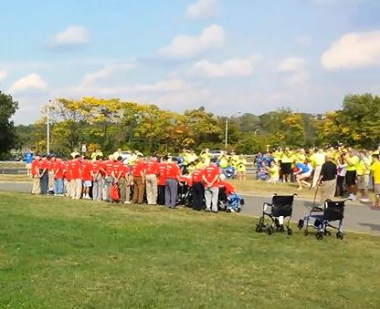 (Syracuse Honor Flight Veterans pose for photo at Iwo Jima Monument, Oct. 5, 2013, after moving barricades)