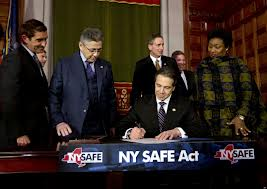 Governor Andrew Cuomo signs New York's SAFE Act gun-control legislation