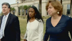 Marissa Alexander, flanked by legal counsel, has trial delayed to July