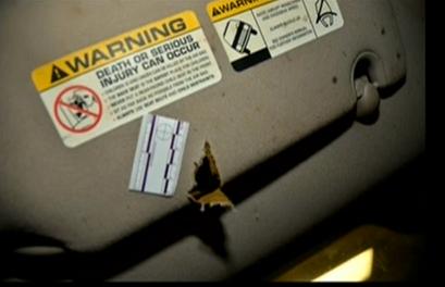 (Bullet strike #3 hit on driver's visor.)