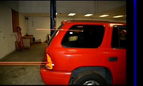(Trajectory rods, final shots, rear of SUV.)