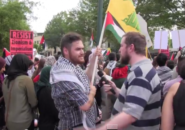 Hezbollah flag Israel protest July 11 2014