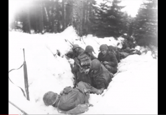 Battle of the Bulge soldiers in snow trench