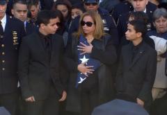 Rafael Ramos family with flag
