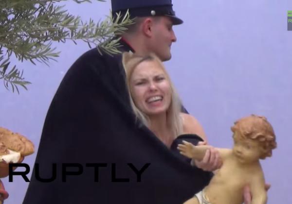 Topless feminist steals baby Jesus from Vatican Nativity Scene FEMEN