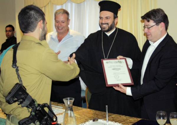 Father Naddaf with soldiers
