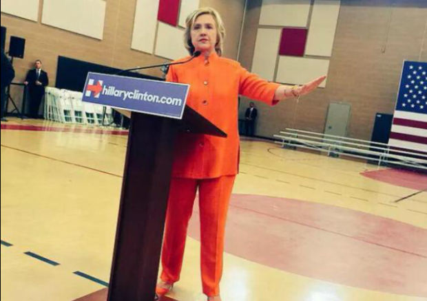 http://legalinsurrection.com/wp-content/uploads/2015/08/Hillary-Clinton-Orange-Pants-Suit-cropped-e1440624696535-620x438.png