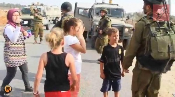 http://www.theblaze.com/stories/2012/11/06/i-spit-in-your-face-mother-goads-palestinian-girl-to-push-scream-at-idf-soldiers-in-propaganda-video-that-backfires/