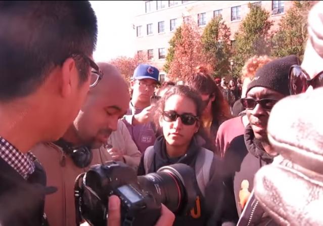[U. Missouri Protesters confront student journalist]