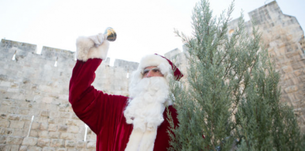 Issa Kassissieh as Santa, Jerusalem 2015 | credit: Breaking Israel News