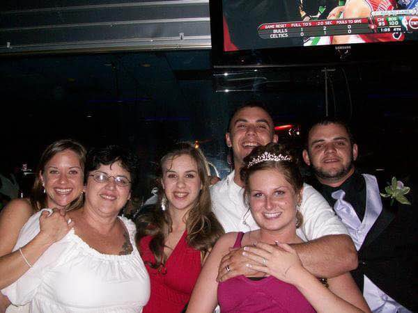 [(left to right) his sister Stephanie, his mom Rachel, his sister Emilie, us, and his brother Ben]