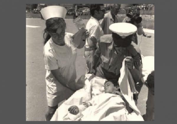 Moshav Avivim Shimon Biton Carried on Stretcher Nurse w border