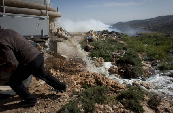 Palestinian driver with waste-water container vehicle | Credit: The Times of Israel