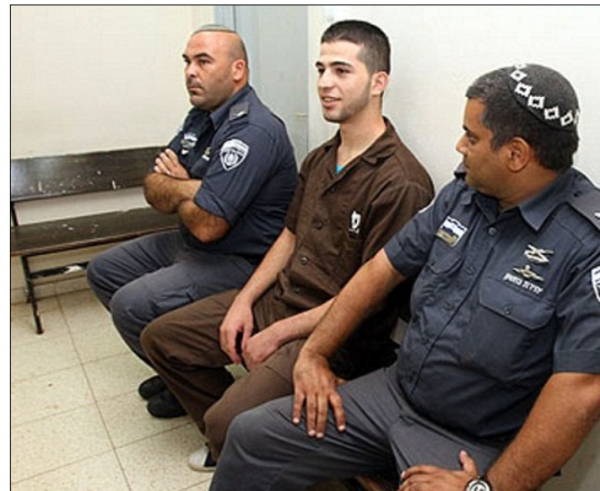 Hakim Awad, center| 5 life sentences for the murder of five members of the Fogel family while they slept, including children ages 11, 4, and 2 months | Credit: Daily Mail