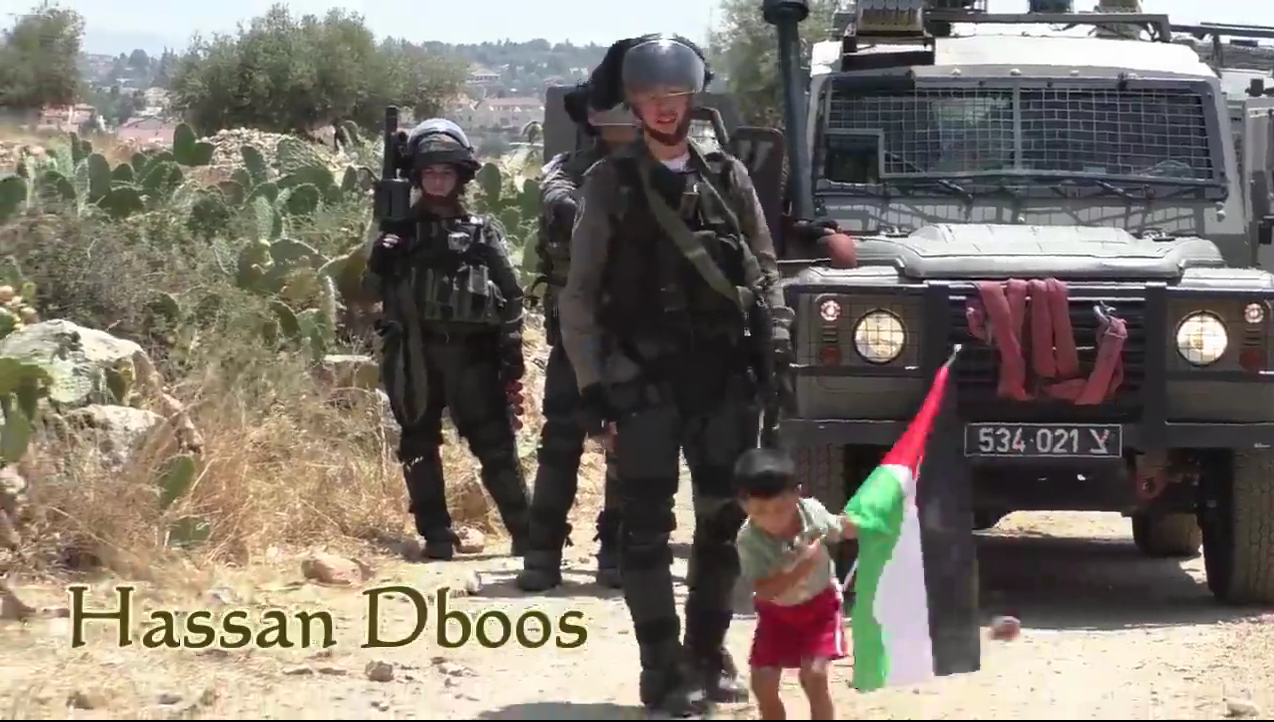 Palestinian child pushed towards soldier video screen shot tossing rock