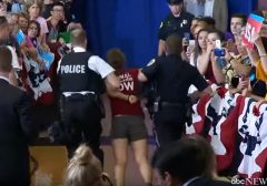 Hillary protester carried away