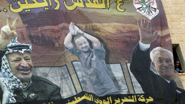 "Poster at Al-Quds University | Jenin, West Bank | shows (left to right) Yasser Arafat, jailed Palestinian Marwan Barghouti, and Mahmoud Abbas | Reads: ""Going to Jerusalem"" 